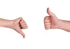 Большие пальцы руки вверх и вниз показывать разногласие стоковое фото rf