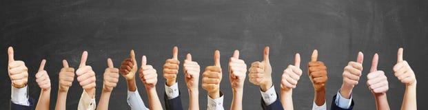 Большие пальцы руки вверх от различных людей Стоковое Фото