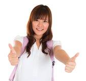Большие пальцы руки поднимают азиатский студента колледжа стоковые фотографии rf