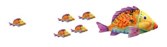 Большие рыбы против маленьких рыб Стоковые Фото