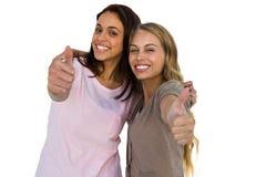 2 большого пальца руки девушек вверх Стоковые Фото