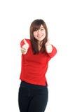 2 большого пальца руки рук поднимают женщину в красном цвете Стоковая Фотография