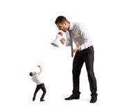 Большой босс кричащий на человеке Стоковая Фотография RF