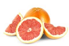 Большой грейпфрут и свеже отрезанный Стоковое фото RF