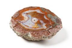 Большой золотой минерал агата на белой предпосылке Стоковые Фото