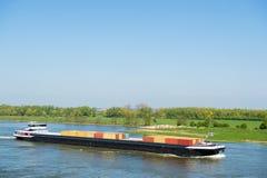 Большой контейнеровоз в ландшафте голландца стоковые фотографии rf