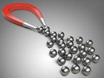 Большой магнит привлекая шарик подшипника хрома Стоковая Фотография