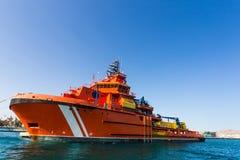Большой оранжевый корабль спасения в морском порте Стоковые Фото