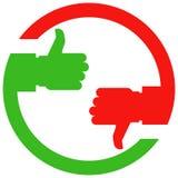 Большой палец руки поднимающий вверх и большого пальца руки руки вниз Стоковые Фото