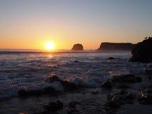 Большой пляж Sur на заходе солнца Стоковые Изображения