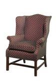 Большой стул крыла обитый в красном старом изолированном антиквариате Стоковое Изображение