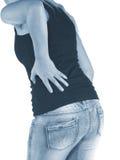 Боль в задней части женщины Стоковые Фото