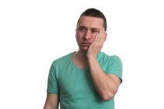 Боль зуба человека страдая на белой предпосылке Стоковые Изображения