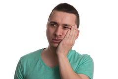 Боль зуба человека страдая на белой предпосылке Стоковое Изображение RF