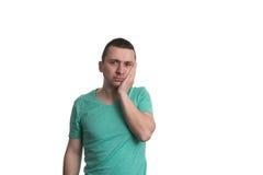 Боль зуба человека страдая на белой предпосылке Стоковое фото RF