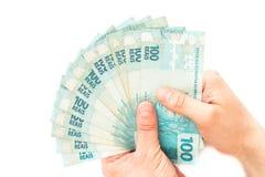 Бразильские деньги, reais, высокие деноминации держали в ладони вашей руки Стоковое фото RF