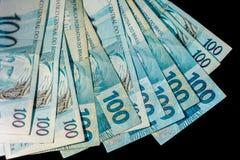 Бразильские счеты денег 100 изолированные на черной предпосылке Стоковые Изображения