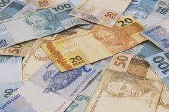 Бразильская предпосылка денег Счеты вызвали Реальн Стоковая Фотография RF
