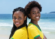 2 бразильских вентилятора на пляже Copacabana на Рио-де-Жанейро Стоковые Изображения