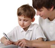 братья делают уроки 2 Стоковое фото RF