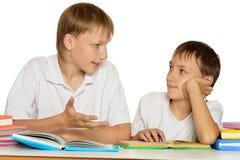 Братья делая домашнюю работу Стоковое Изображение
