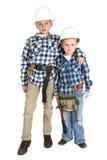 2 брать обнимая в защитных шлемах конструкции Стоковое Изображение