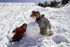 2 брать с снеговиком Стоковая Фотография