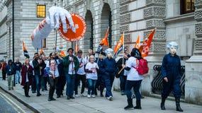 Британия заслуживает подъем оплаты - закончите марш протеста крышки теперь Стоковое Фото