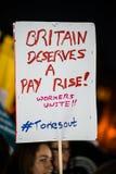 Британия заслуживает подъем оплаты - закончите марш протеста крышки теперь Стоковое Изображение