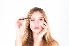 брови ее женщина красок женщина с ручкой стоковое изображение
