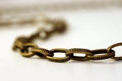 бронзовое цепное золото Стоковая Фотография