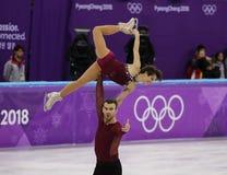Бронзовые медалисты Meagan Duhamel и Эрик Radford Канады выполняют в парах катаясь на коньках свободно катающся на коньках на 201 Стоковое Фото