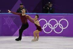 Бронзовые медалисты Meagan Duhamel и Эрик Radford Канады выполняют в парах катаясь на коньках свободно катающся на коньках на 201 Стоковые Изображения