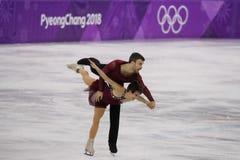 Бронзовые медалисты Meagan Duhamel и Эрик Radford Канады выполняют в парах катаясь на коньках свободно катающся на коньках на 201 Стоковое Изображение RF