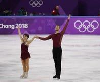 Бронзовые медалисты Meagan Duhamel и Эрик Radford Канады выполняют в парах катаясь на коньках свободно катающся на коньках на 201 Стоковая Фотография