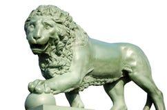 Бронзовый лев на белой предпосылке Стоковое Изображение