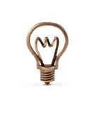 Бронзовый символ электрической лампочки Стоковые Фото