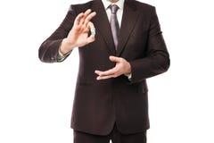 Бросать бизнесмена dices изолированный на белизне Стоковое Изображение RF