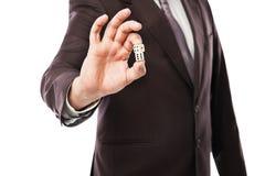 Бросать бизнесмена dices изолированный на белизне Стоковые Фотографии RF