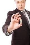 Бросать бизнесмена dices изолированный на белизне Стоковое фото RF