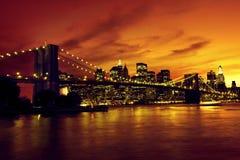 Бруклинский мост и Манхаттан на заходе солнца, Нью-Йорк Стоковые Фотографии RF