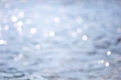 Брызгает воды в солнце нет фокуса bluets Стоковое Изображение