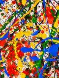 Брызгает на красной и черной и зеленой и желтой и голубой краске стоковые изображения rf