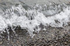 Брызг дунутый от волн Стоковые Изображения