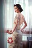 Брюнет в платье свадьбы Стоковая Фотография RF