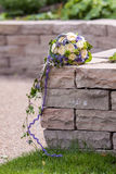 Букет свадьбы на стене песчаника Стоковое Фото