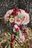 Букет свадьбы Marsala цветков Стоковые Изображения