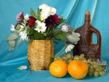 Букет цветков, апельсинов, бутылки вина, стекел Collag Стоковое фото RF