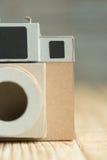 Бумага камеры на деревянной предпосылке Стоковое Изображение RF