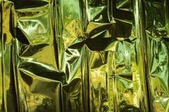 бумага предпосылки золотистая Стоковое фото RF